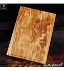 Large chopping board of olive wood with juice groove